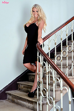 Cara Brett exposes her massive boobs on the stairs