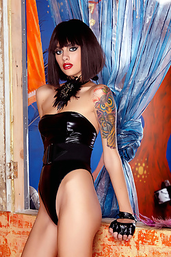 Emma Mae seduces in black latex and high heels