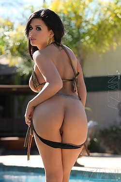 Brunette beauty Eva Angelina strips out of her sexy gold bikini by the pool