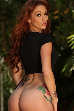 The beautiful red head Monique Alexander strips from her sexy outfit