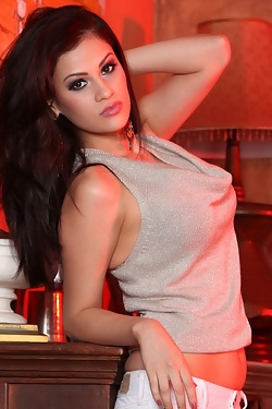 The beautiful Vanessa Veracruz does a slow sexy striptease and shows off her curves