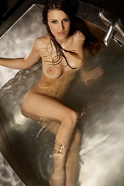 Andie Valentino really enjoys playing with herself  when taking a bath by aiming the water from the faucet onto her sensative nipples and pussy.