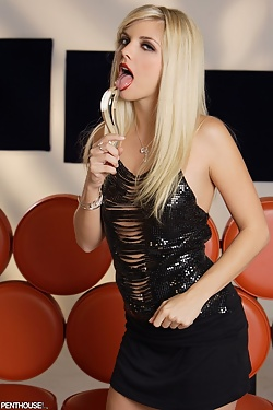 Jana Jordan does naughty things with her tongue to her favorite glass toy.