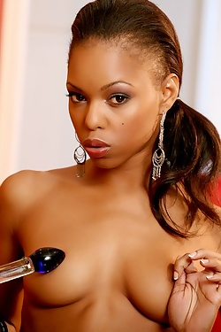Pretty black nympho playing with her titties and pussy