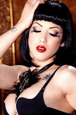 Asphyxia Noir will tighten your pants with her ivory skin and penetrating stare