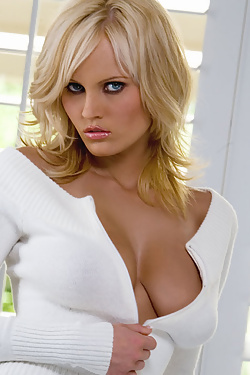 Hannah Hilton revealing her breasts from an open white sweater and flashing her pussy and pink panties in bed.